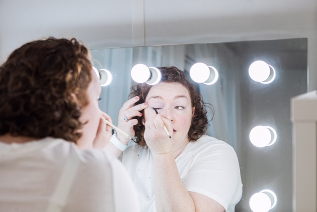 Women shows how to put on eye makeup as one of top makeup tips for London mums