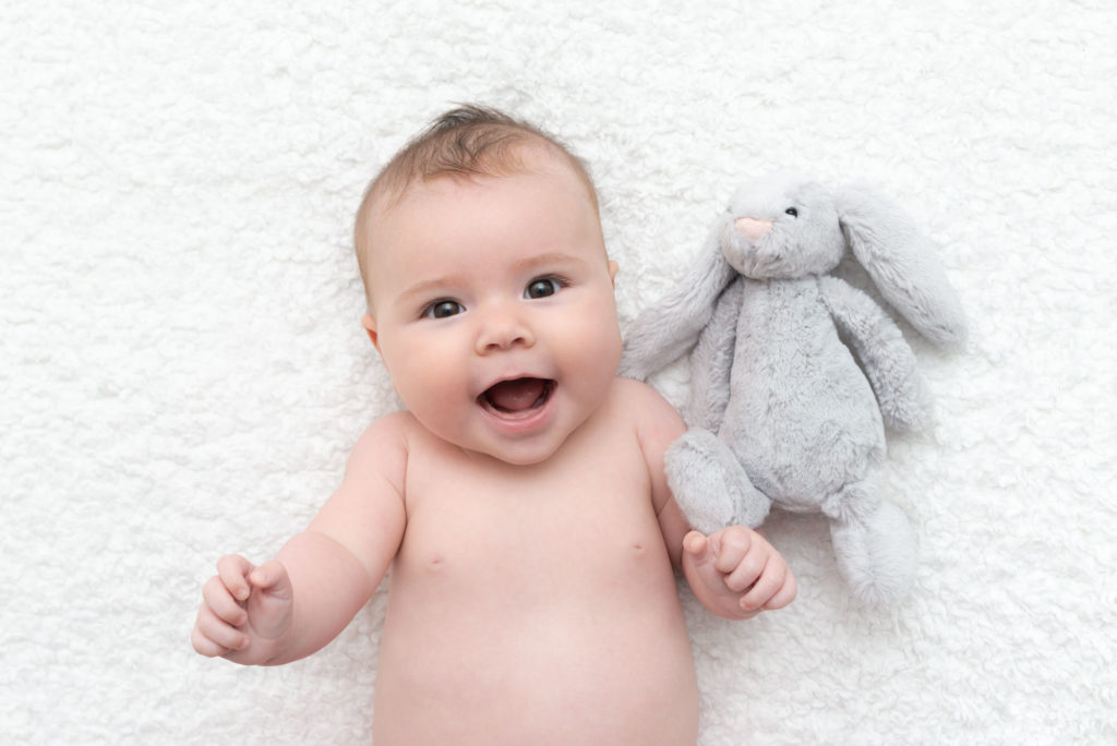 Baby with grey rabbit taken by Greenwich baby photographer in South East London