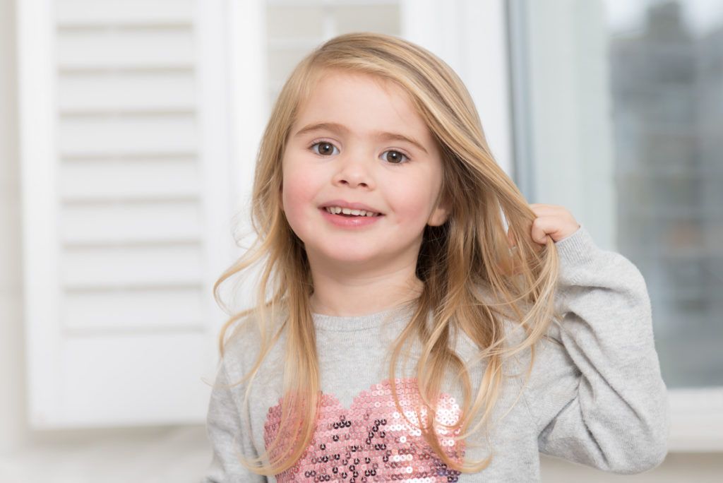 Portrait of blond girl at children's photography session in Barnes, West London