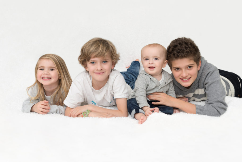 Photo of four children on the bed Beckenham, South London