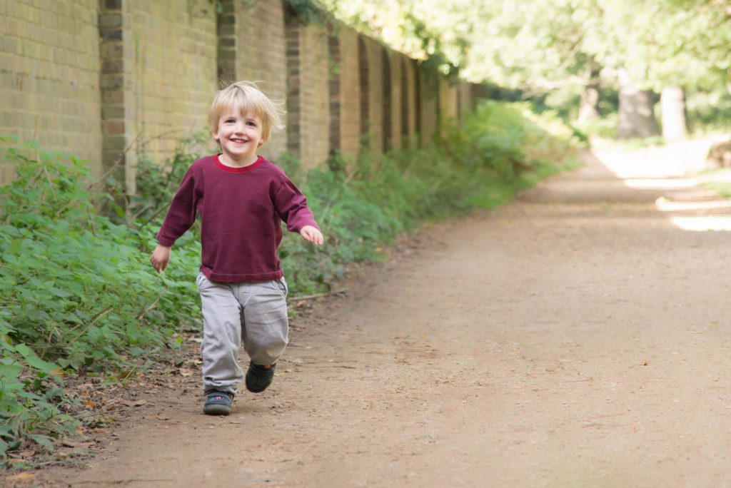 Photo of child running through the park in Canary Wharf, East London