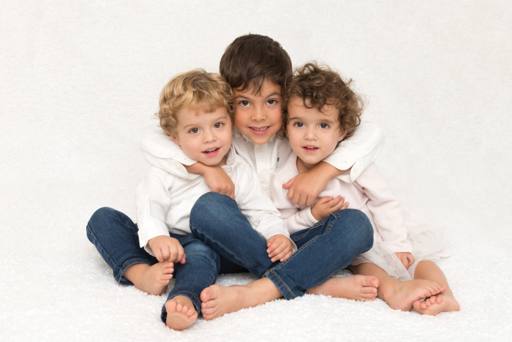 Portrait taken of three siblings at a child photoshoot in Fulham, South West London