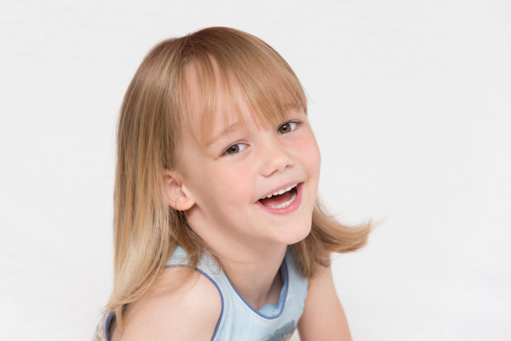 Putney child photography session - 6-yr old girl strikes a pose in West London