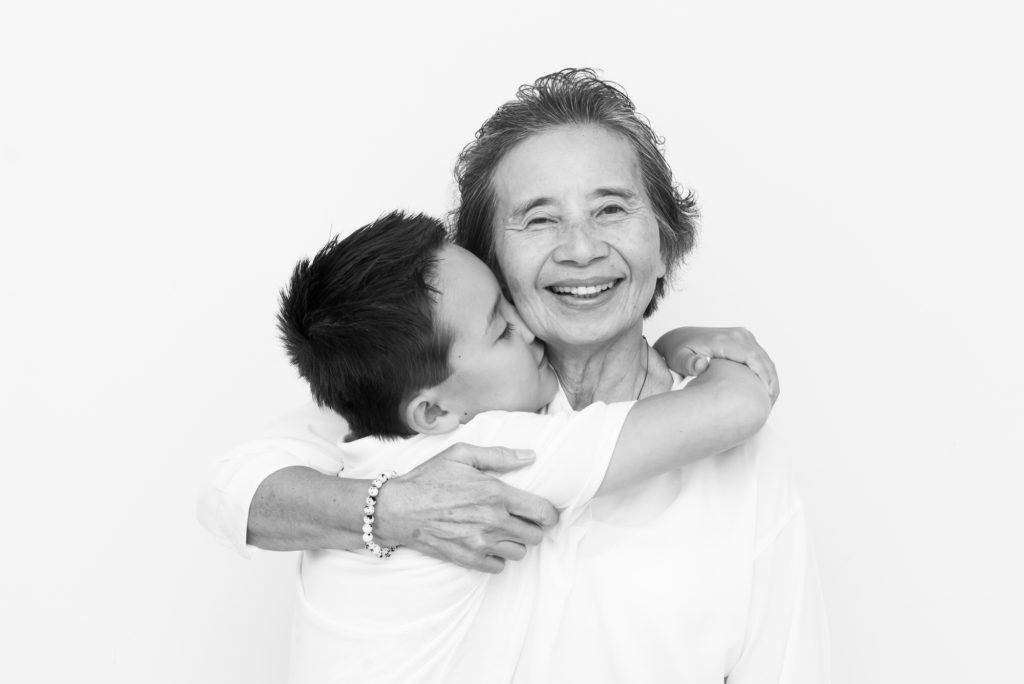 Boy kissing grandma taken at family photoshoot in Dulwich, South London