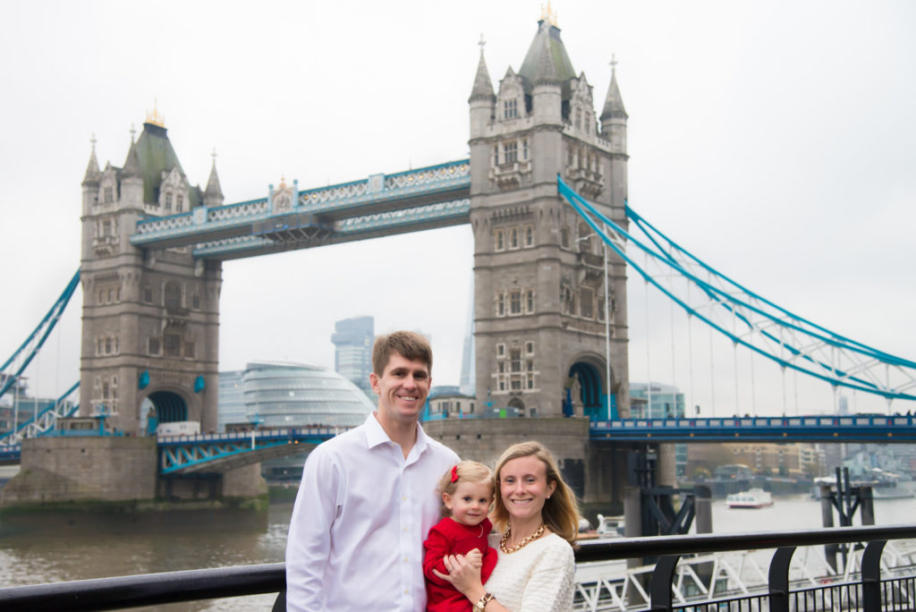 Parents with their child at Tower Bridge, London by professional lifestyle photographer