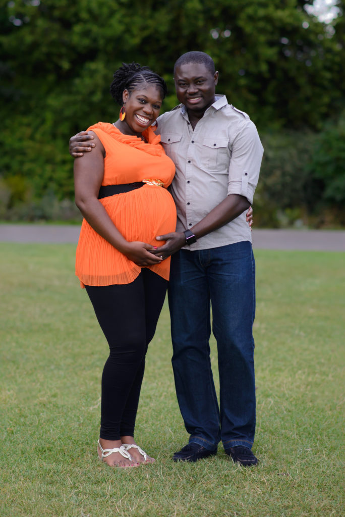 Pregnant couple posing in Crystal Palace park by South East London maternity photographer