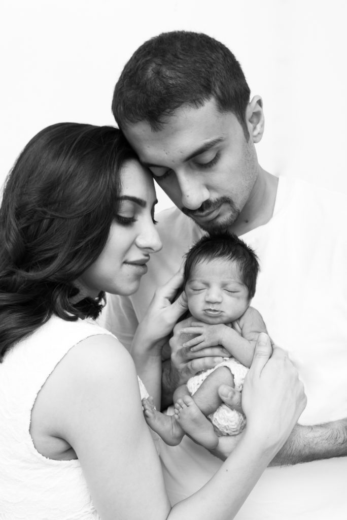 Black and white portrait of family with baby at newborn photoshoot in Kensington, Central London